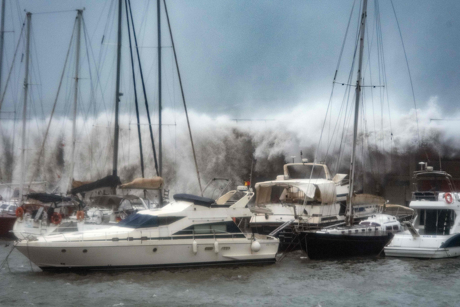 Big waves overtake a breakwater at the Port Olympic marina in Barcelona as storm Gloria batters Spain's eastern coast on Jan. 21. JOSEP LAGO/AFP via Getty Images