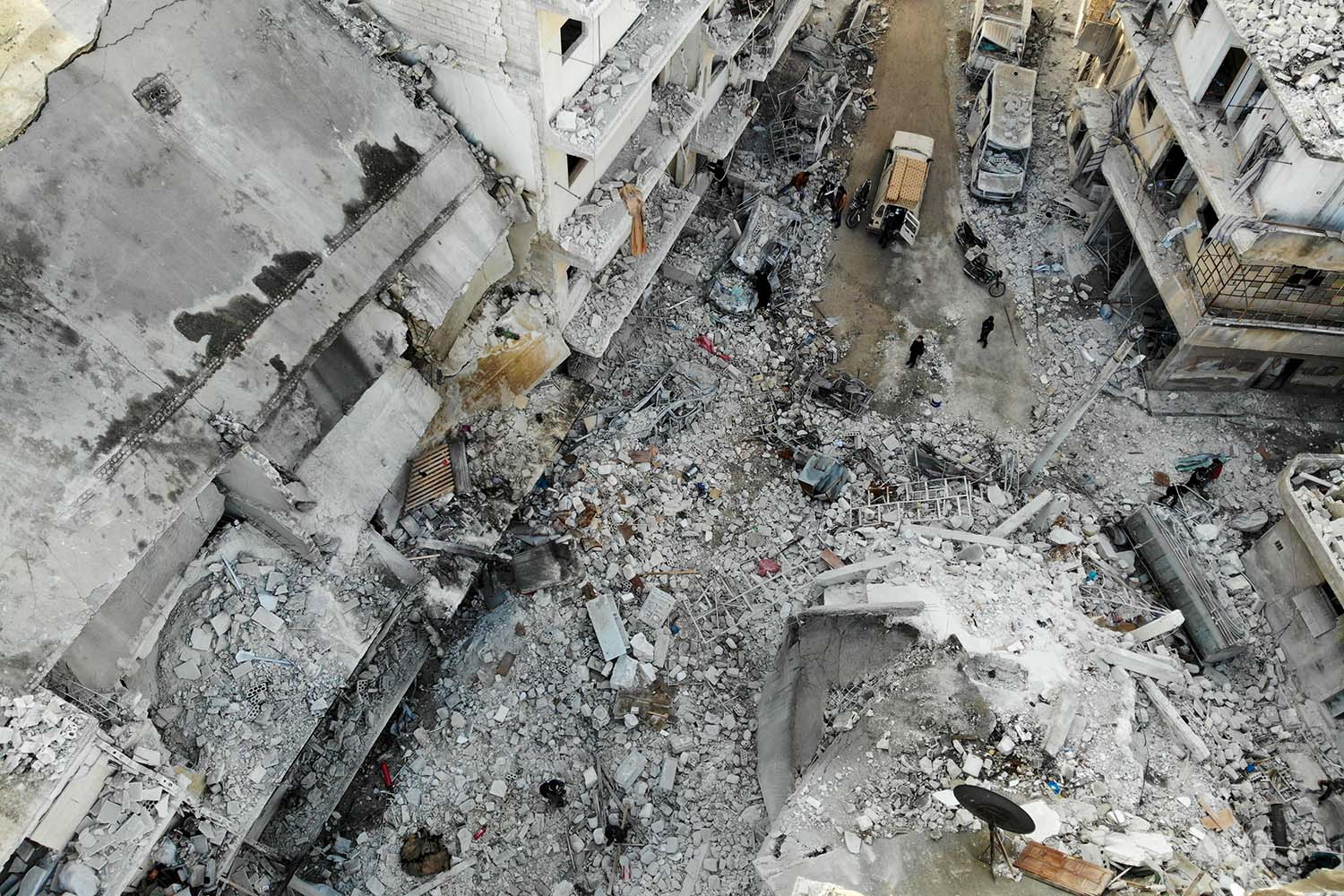 An aerial view shows the rubble and debris at the site of reported airstrikes on the rebel-held town of Ariha in the northern countryside of Syria's Idlib province on Jan. 30. OMAR HAJ KADOUR/AFP via Getty Images