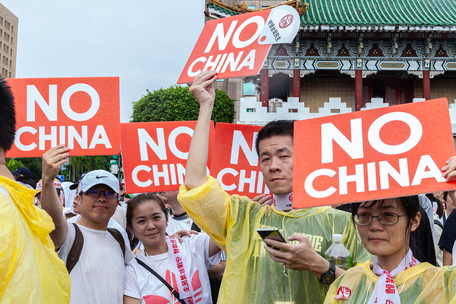 Protesters in Taipei hold signs stating their opposition to Chinese media disinformation and the Chinese Communist Party's authoritarian rule in China on June 23, 2019.