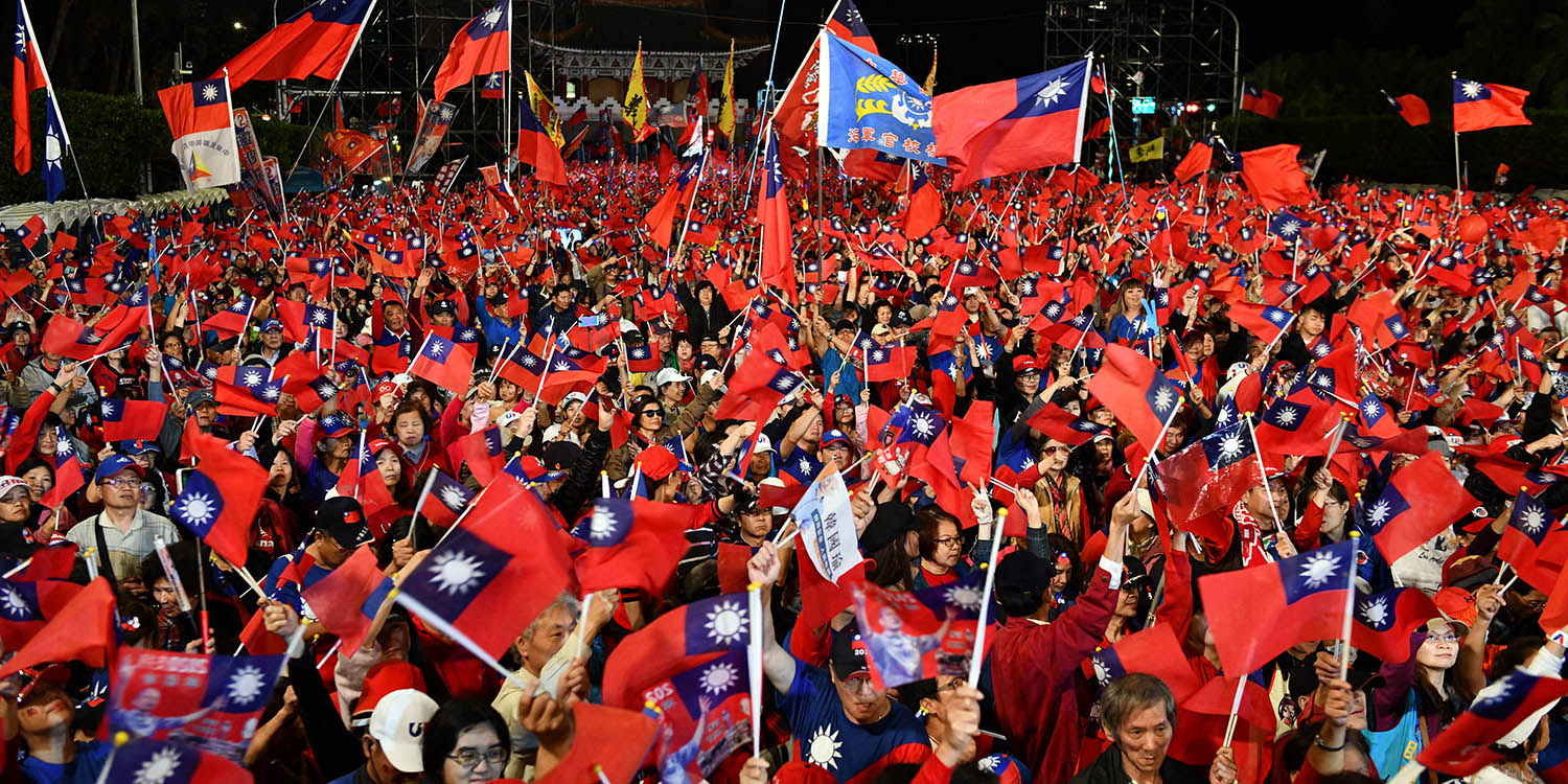 Supporters wave Taiwanese flags during a campaign rally for Han Kuo-yu, the Kuomintang candidate and more pro-Beijing challenger to the sitting president, in Taipei on Jan. 9.
