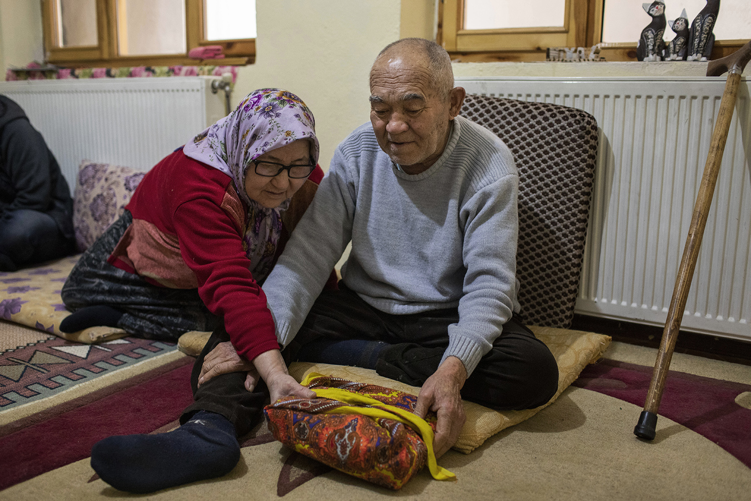 Gulchaman Nowruzi, 65, with her husband, Khodadad Yaqubi, 76, holds a Quran, the only possession they still have from their home in Mazar-e-Sharif, Afghanistan, at their new home in Van, Turkey on March 1, 2019. The Afghan refugees first fled to Iran in 1982 and then to Turkey, where they now live temporarily with their two daughters, in 2018.