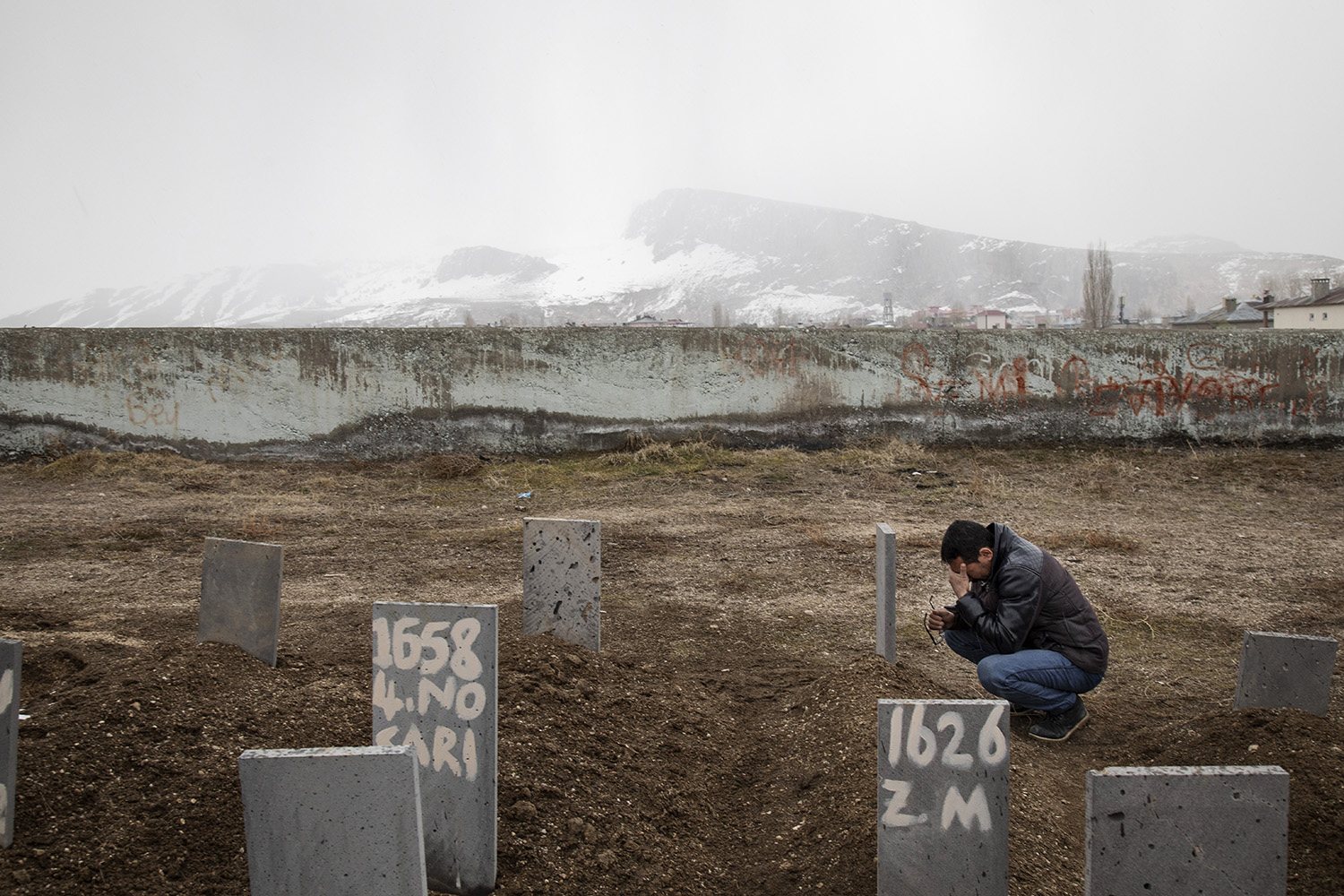 Hamdi, a refugee from Afghanistan who didn't want to use his full name, visits the grave of his 4-year-old daughter, Zehra, in a cemetery for unidentified victims and those who cannot afford a grave plot in Van, Turkey, on March 3, 2019. Zehra died in a traffic accident while her family attempted to travel across Turkey to Europe.