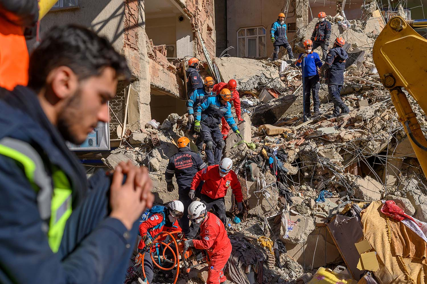 Rescue workers sift through the rubble of a building after an earthquake in Elazig, eastern Turkey, on Jan. 25. The magnitude 6.8 quake killed at least 41 and injured hundreds. BULENT KILIC/AFP via Getty Images