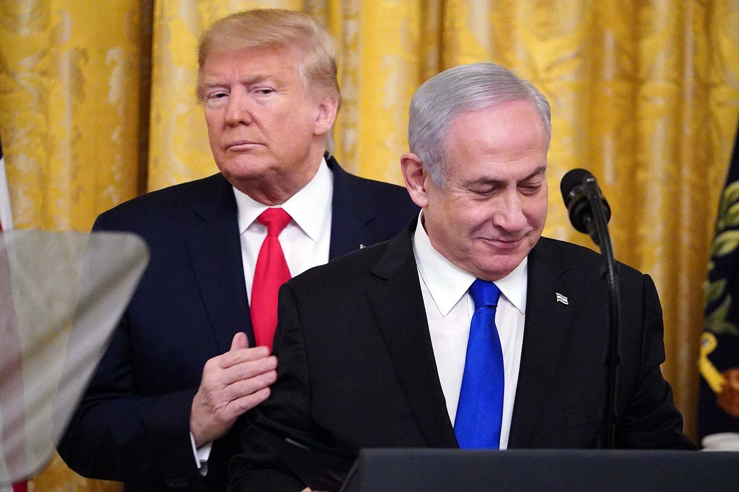 U.S. President Donald Trump and Israeli Prime Minister Benjamin Netanyahu annouce Trump's Middle East peace plan at the White House in Washington on Jan. 28. MANDEL NGAN/AFP via Getty Images