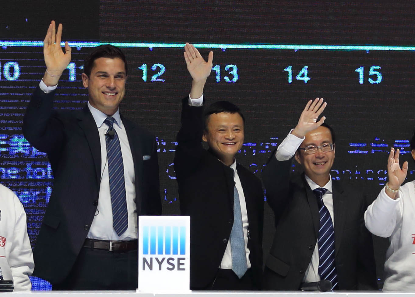 New York Stock Exchange President Tom Farley, Alibaba Chairman Jack Ma, and Alibaba CEO Daniel Zhang attend a long-distance ringing of the opening bell in New York from Beijing on Nov. 11, 2015.