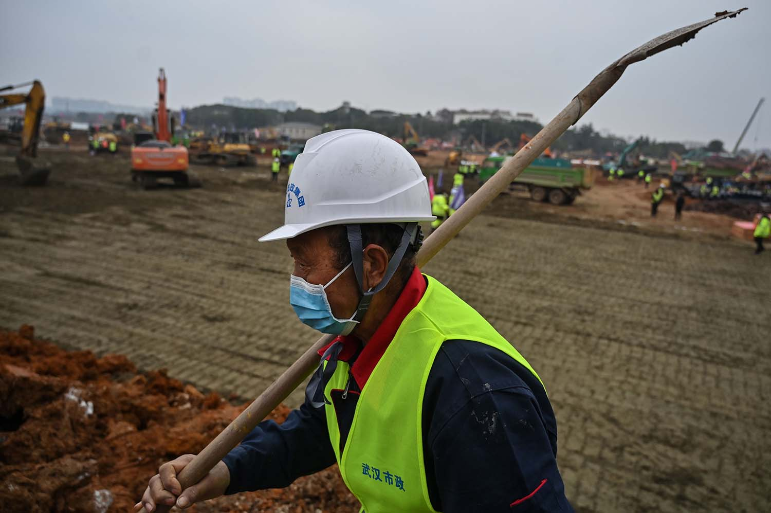 A worker at the construction site of a new hospital being built to treat patients from the deadly virus outbreak in Wuhan on Jan. 27. HECTOR RETAMAL/AFP via Getty Images