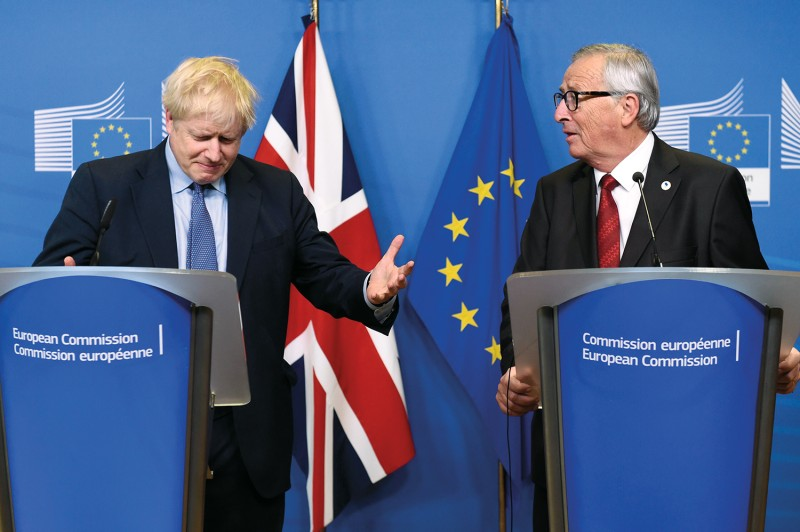 U.K. Prime Minister Boris Johnson and Jean-Claude Juncker, then-president of the European Commission, in Brussels on Oct. 17, 2019.
