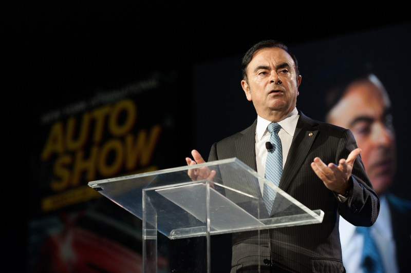 Then-Nissan CEO Carlos Ghosn speaks during the beginning of the New York International Auto Show's press day in New York.
