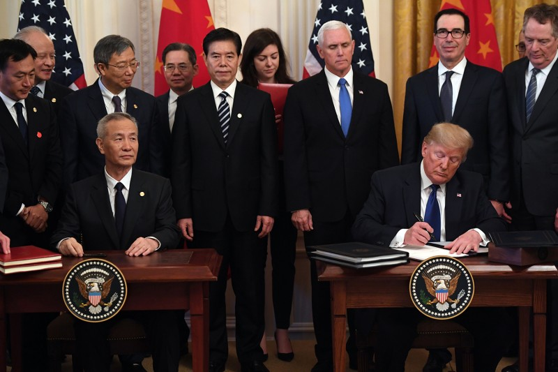 U.S. President Donald Trump, and Chinese Vice Premier Liu He sign trade agreements between the U.S. and China at the White House on Jan. 15 in Washington.