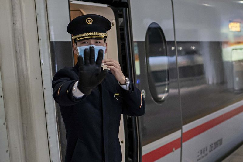 A train controller wearing a face mask in Beijing