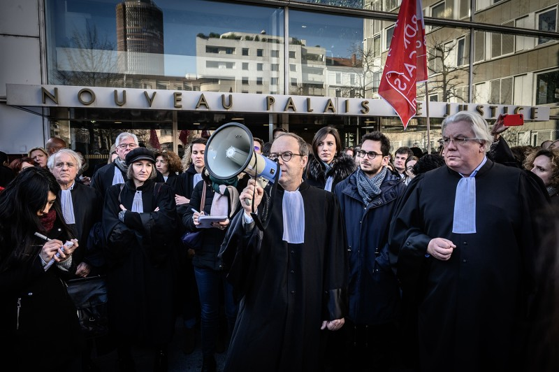 Lawyers take part in a demonstration against the French government's plan to overhaul the country's retirement system, on Jan. 6 in Lyon, France.