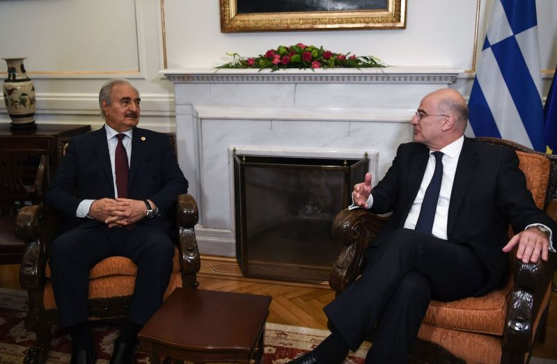 Greek Foreign Minister Nikos Dendias (right) meets with Libyan strongman Khalifa Haftar (left) in Athens, Greece, on Jan. 17, 2020, ahead of a peace conference in Berlin aimed at ending the civil war in Libya.