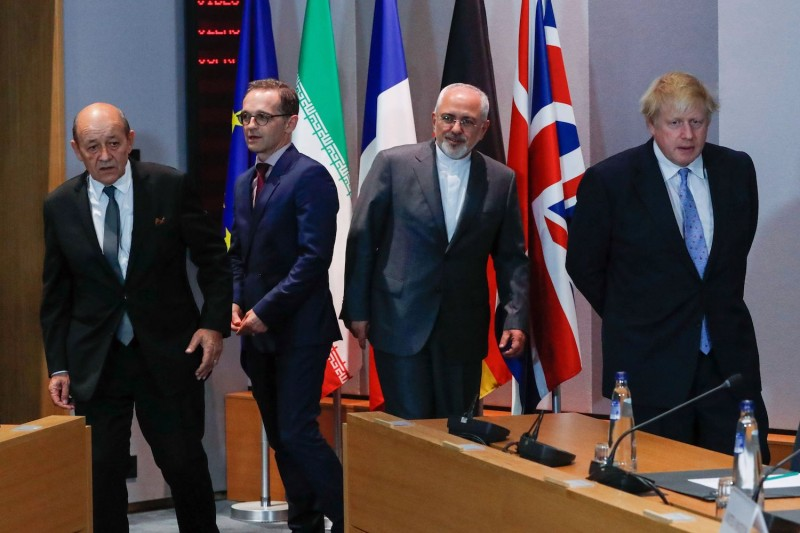 Iran's Foreign Minister Mohammad Javad Zarif (C) with Britain's then-Foreign Secretary Boris Johnson (R), France's Foreign Minister Jean-Yves Le Drian (L), Germany Foreign Minister Heiko Maas (2nd L) at the EU headquarters in Brussels on May 15, 2018.