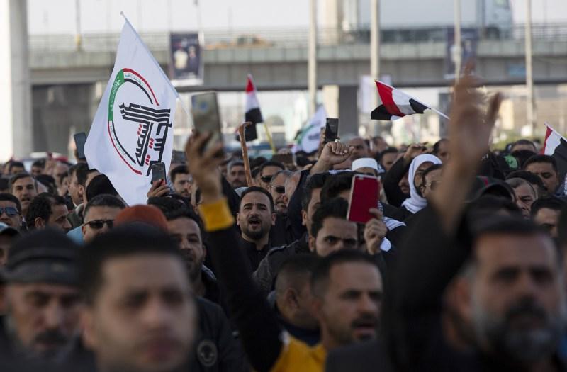 Iraqis march in a symbolic funeral procession for senior Iraqi military figure Abu Mahdi al-Muhandis,  killed alongside Iranian Maj. Gen. Qassem Suleimani last week, on Jan. 5 in Basra, Iraq.
