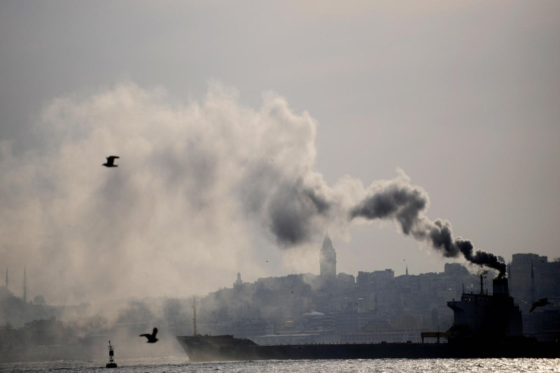 A ship spewing heavy smoke is pictured on the Bosphorus in Istanbul on April 21, 2009.