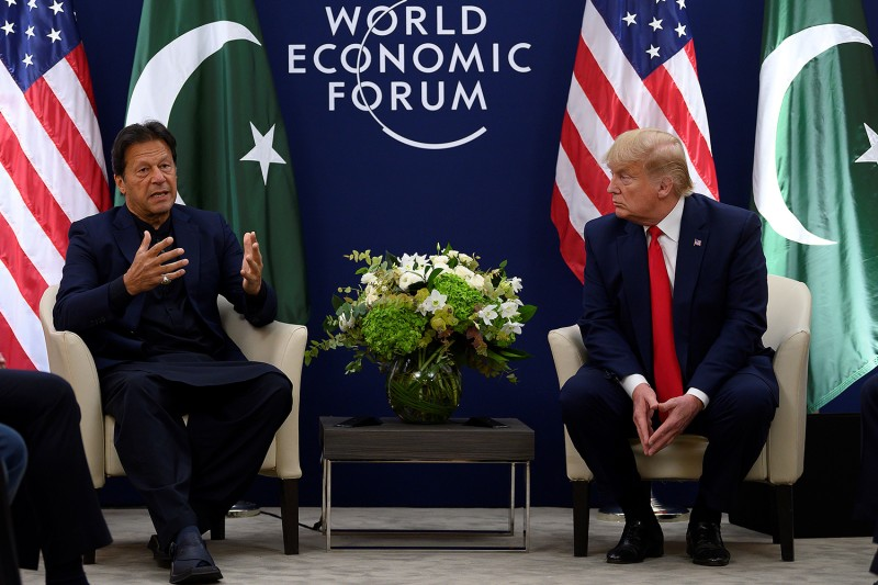 U.S. President Donald Trump speaks with Pakistani Prime Minister Imran Khan ahead of their meeting at the World Economic Forum in Davos, Switzerland, on Jan. 21.
