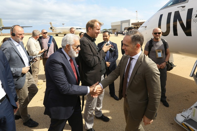 Libya's Foreign Minister Mohamed Taher Siala welcomes his German counterpart, Heiko Maas, in Tripoli on Oct. 27, 2019.