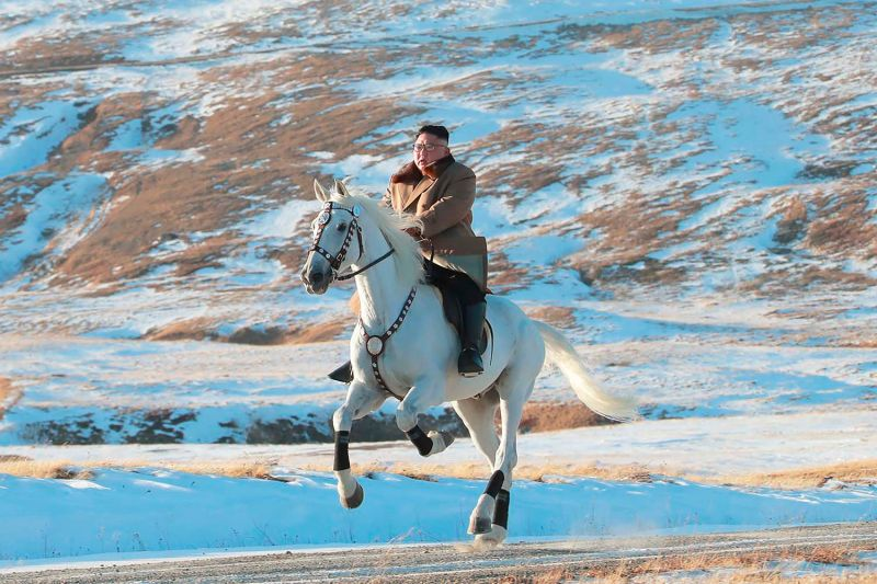North Korean leader Kim Jong Un rides a white horse to climb Mount Paektu in an image distributed on Oct. 16, 2019, by the North Korean government.