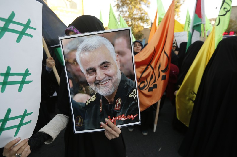 Iranian protesters hold a portrait of the commander of the Iranian Revolutionary Guard's Quds Force, Gen. Qassem Suleimani, during a demonstration in Tehran on Dec. 11, 2017.