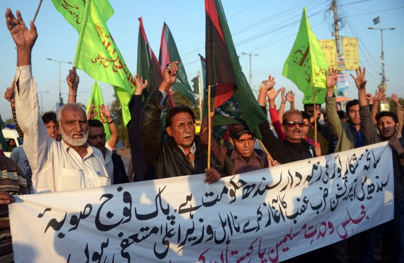 Shiite Muslims protest in Karachi, Pakistan, against a suicide bombing at a Shiite mosque.