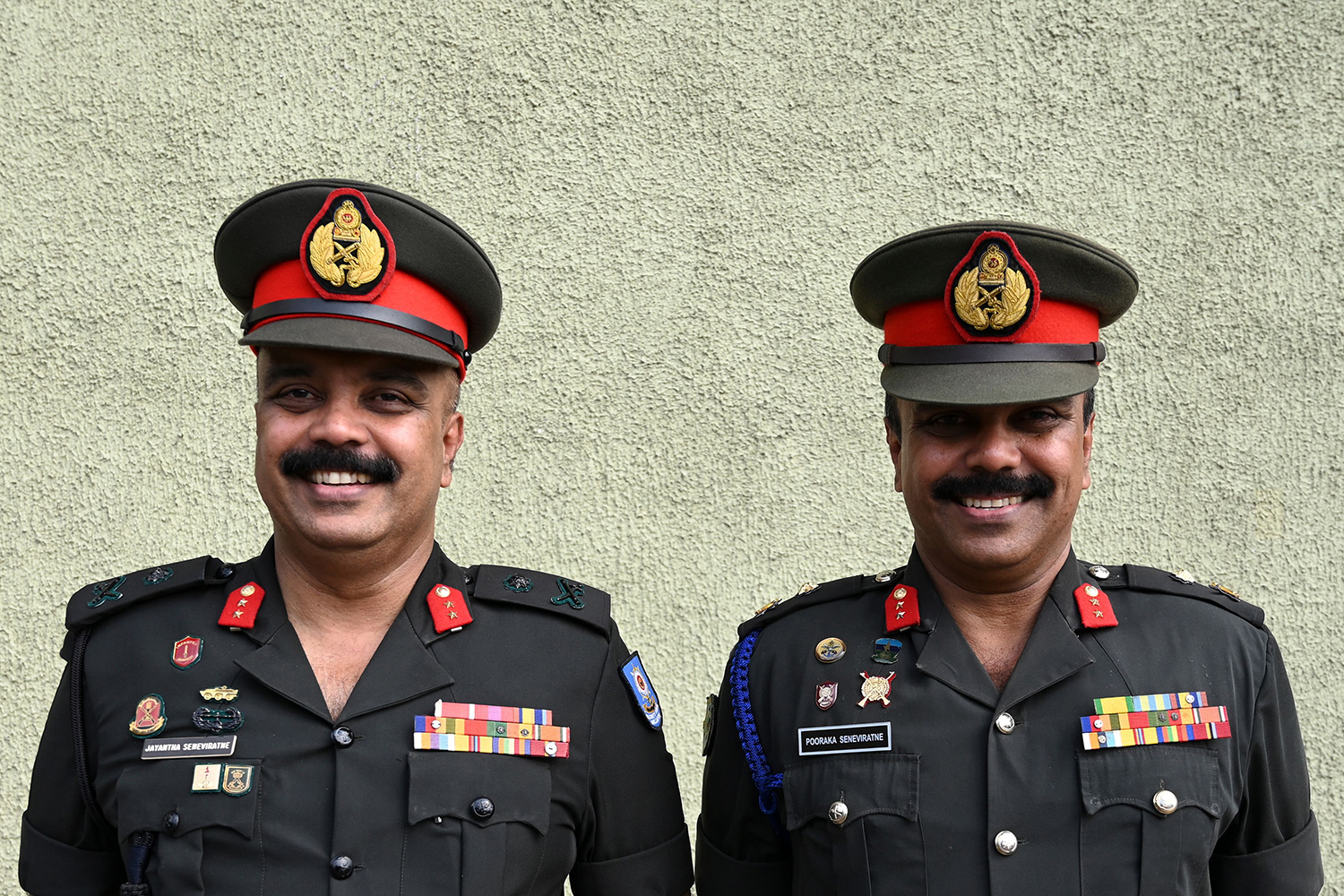 Sri Lankan Army Gens. Jayantha and Pooraka Seneviratne, pose for a picture during an attempt to break the world record for the biggest gathering of twins on Jan. 20 in Colombo, Sri Lanka.