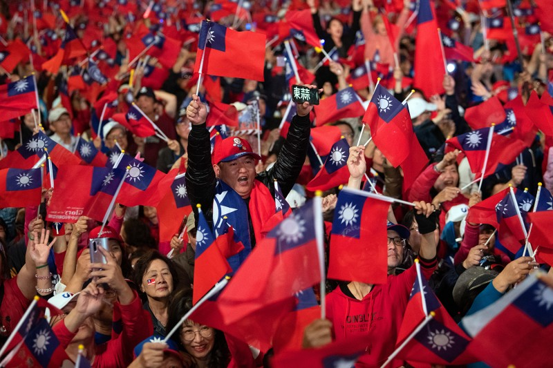Supporters wave Taiwanese flags during a campaign rally ahead of Saturday's election, on Jan. 9 in Taipei.