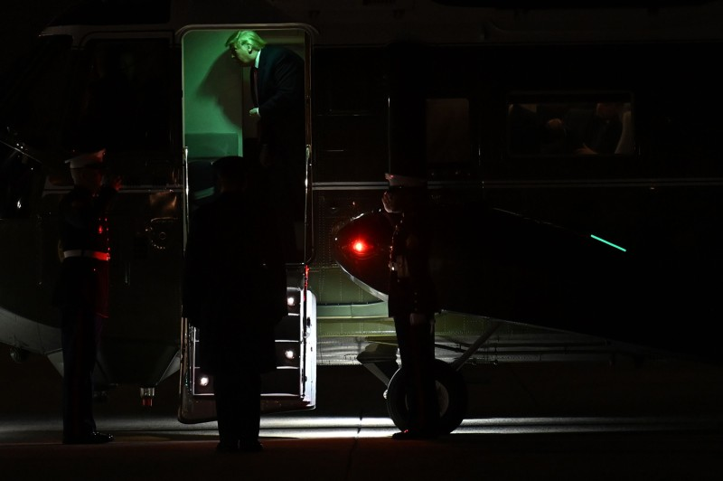 U.S. President Donald Trump exits Marine One to board Air Force One at Andrews Air Force Base on Jan. 20, as he prepares to travel to Davos, Switzerland.