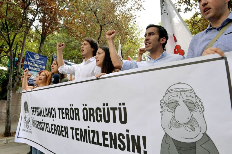 Pro-nationalist university students shout during a protest against the U.S.-based cleric Fethullah Gulen and his followers during a demonstration in Ankara on July 21, 2016.