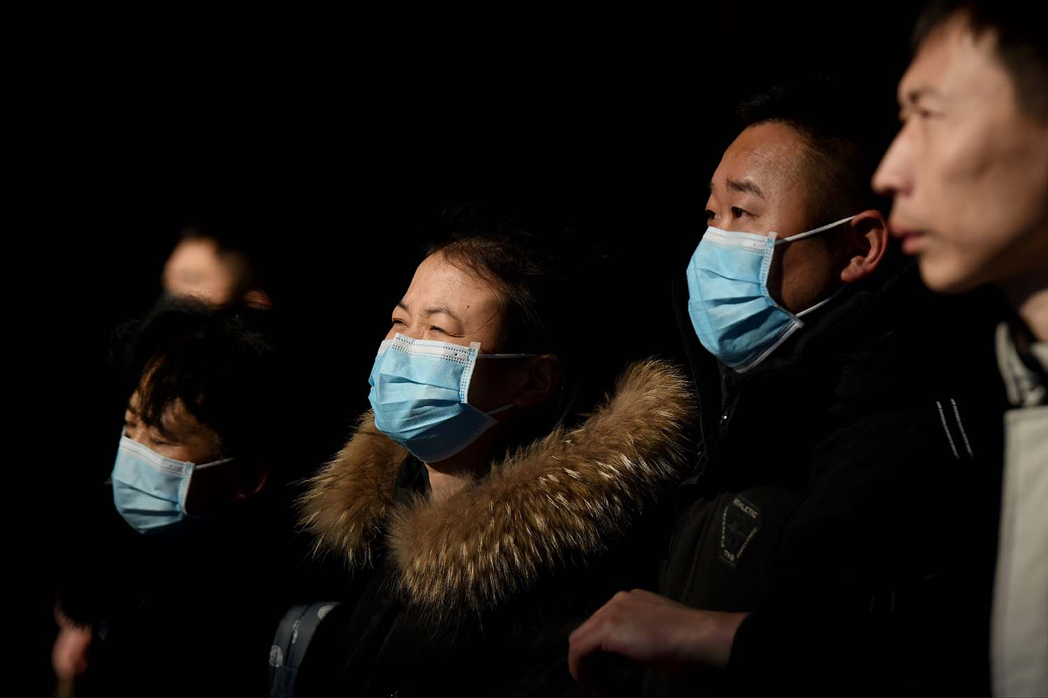 Passengers wear face masks as they travel through the Beijing railway station on Jan. 24.