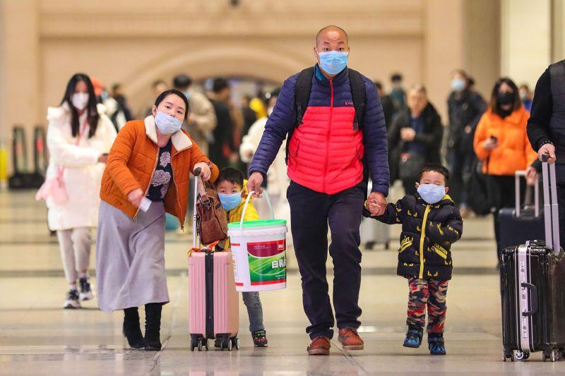 People wearing face masks walk in Hankou railway station in Wuhan, China, on Jan. 21.