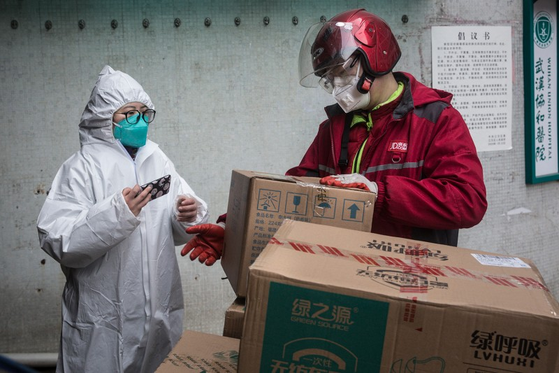 A courier delivers supplies to the Wuhan Union Hospital on Jan. 29 in Wuhan, China.