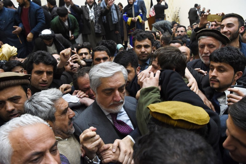 Afghan presidential candidate Abdullah Abdullah (center) arrives at a news conference after the announcement of the final presidential election results in Kabul on Feb. 18.