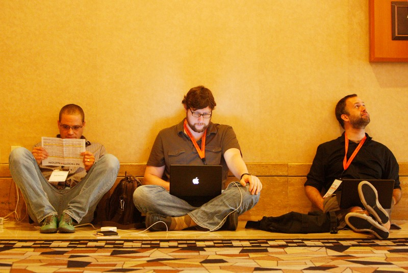 Matt Duss (center) attends the Netroots Nation progressive bloggers conference in Las Vegas on July 24, 2010.