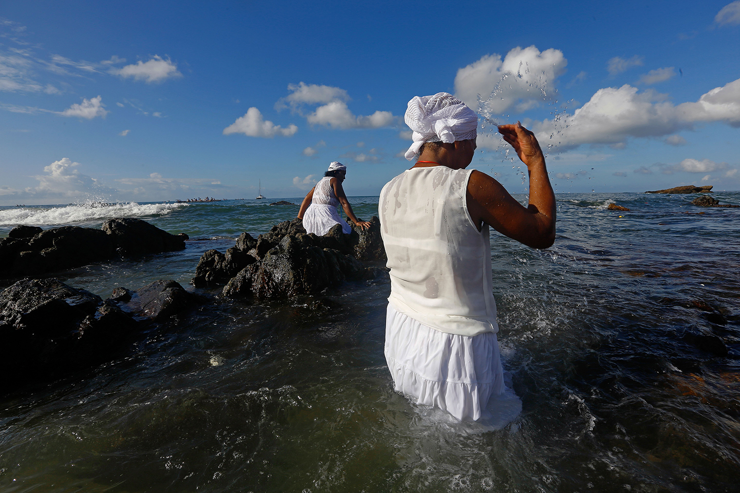 Worshippers take part in the traditional ceremony of Iemanja, the goddess of the sea of the Afro-Brazilian religion Umbanda, in Salvador, Bahia, Brazil on Feb. 2. RAFAEL MARTINS/AFP via Getty Images