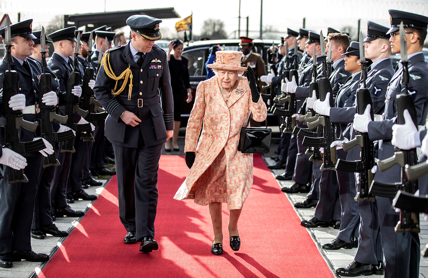 Britain's Queen Elizabeth II pases a guard of honor as she arrives at Royal Air Force base Marham, eastern England, on Feb. 3.  RICHARD POHLE/POOL/AFP via Getty Images