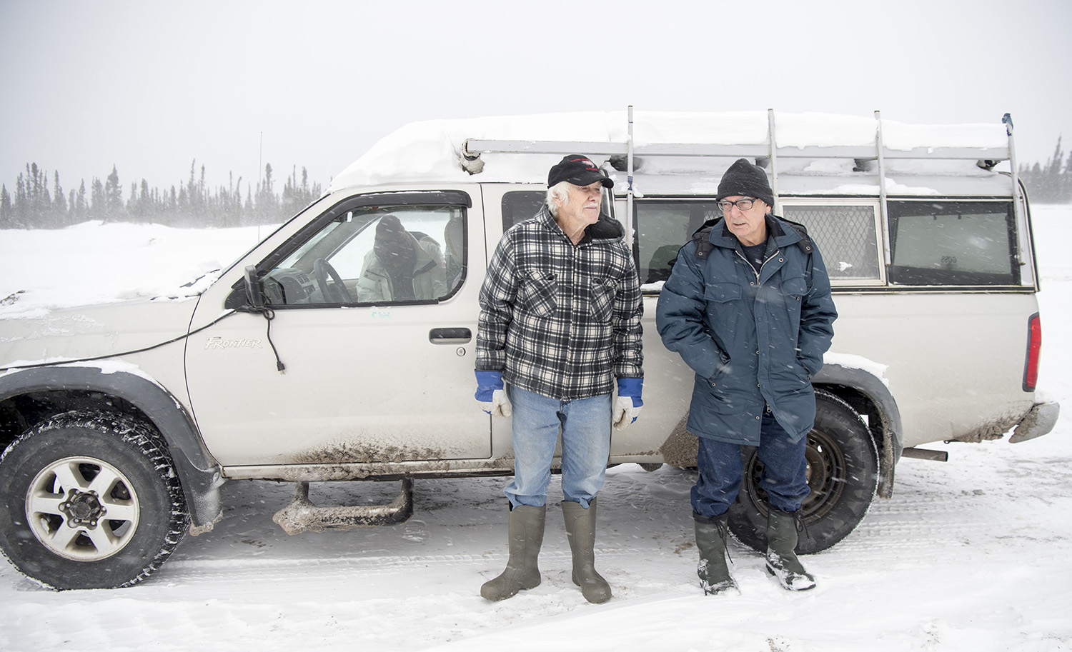 Jim Learning, left, and Davis stand by Learning's truck at the gate to Muskrat Falls Generating Facility on the North Spur near Happy Valley-Goose Bay, Newfoundland and Labrador, on Nov. 16, 2019.