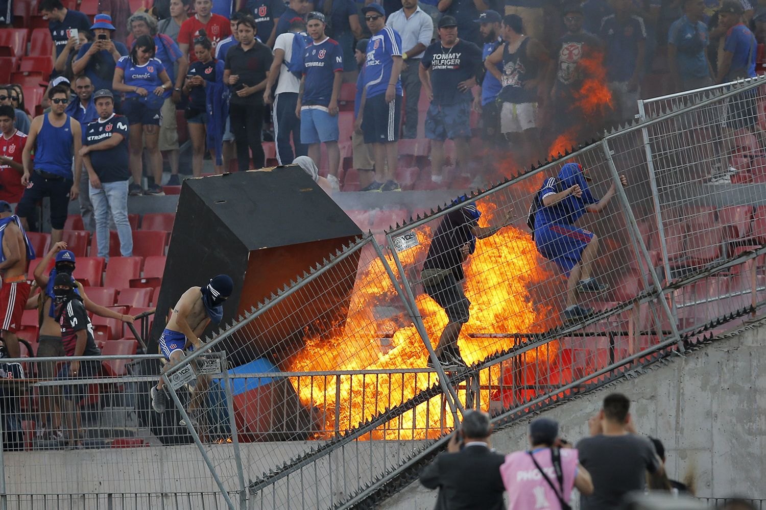 Chile's Universidad de Chile supporters set a fire in the stands during the Copa Libertadores football match against Brazil's Internacional at the National stadium in Santiago on Feb. 4. JAVIER TORRES/AFP via Getty Images
