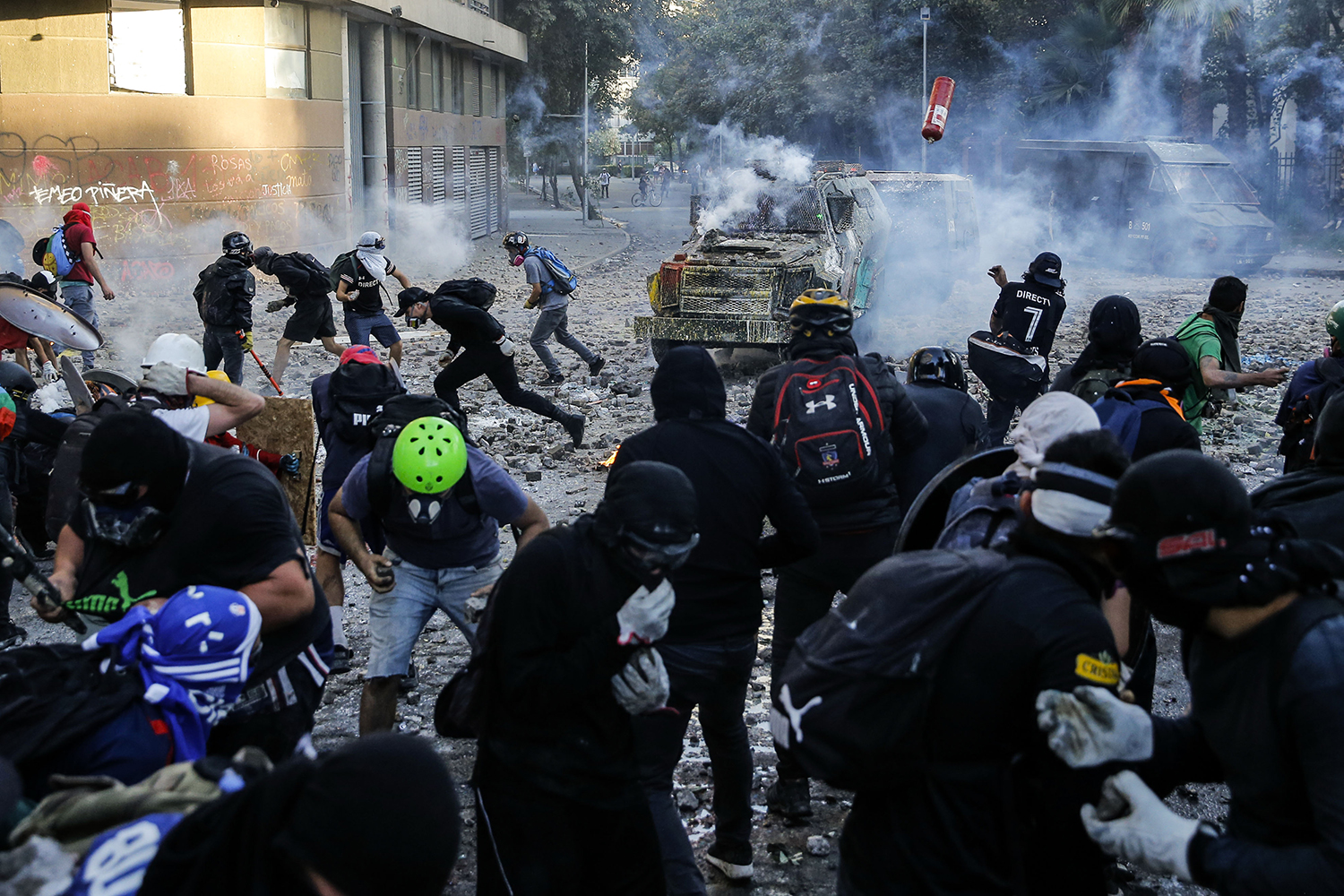 Demonstrators clash with riot police during a protest against Chilean President Sebastian Pinera's government in Santiago on Feb. 7.  JAVIER TORRES/AFP via Getty Images