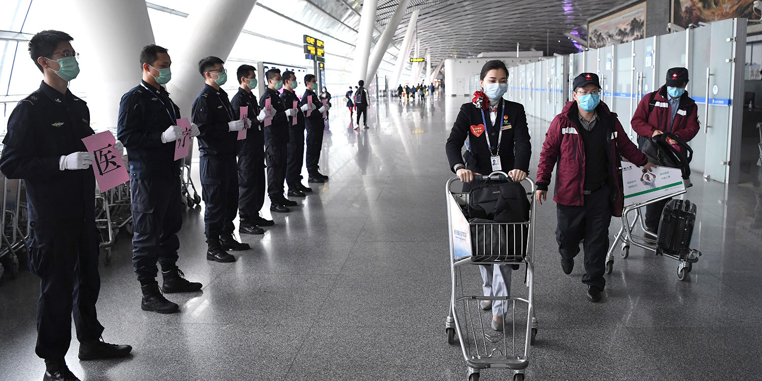 Airport staff bid farewell to medical team members before their departure for Shiyan in Hubei province from Nanning, China, on Feb. 12.