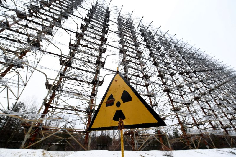 A sign with the radiation warning symbol in front of the construction of the Duga Soviet over-the-horizon radar system near Chernobyl, Ukraine, on Nov. 22, 2018.