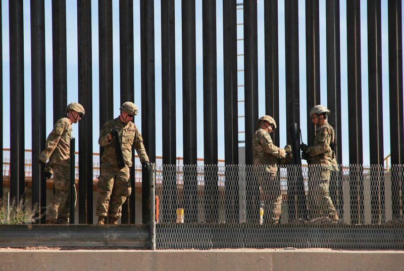 U.S. soldiers reinforce the U.S.-Mexico border fence