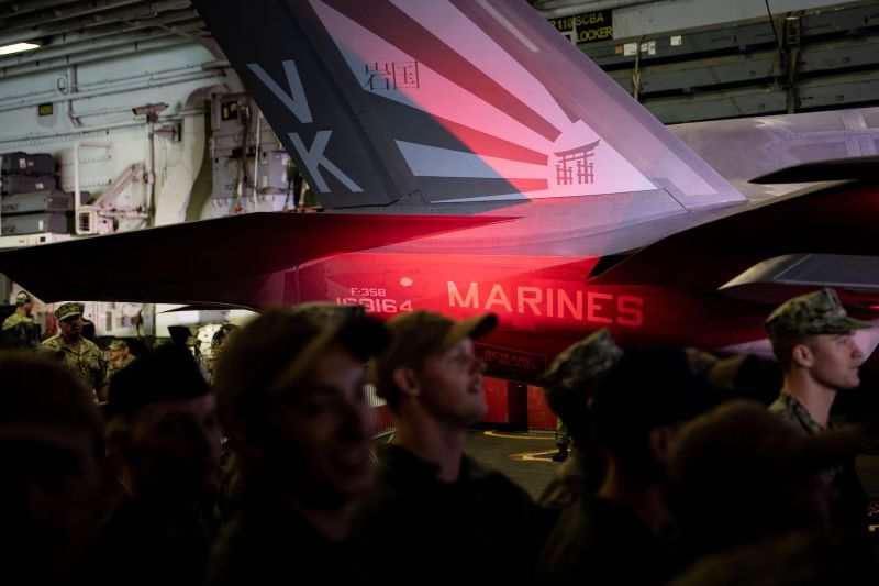 Troops stand near an F-35 while they listen as U.S. President Donald Trump speaks on board the USS Wasp in Yokosuka, Japan, on May 28, 2019.