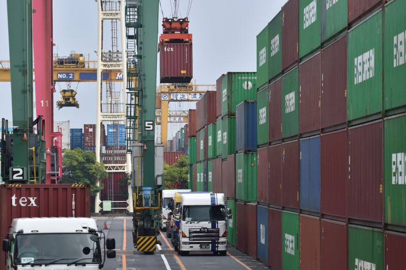 Containers are transferred to trucks at the Port of Tokyo on Aug. 19, 2019. Japan's trade surplus with the United States, like that of many other countries, has fueled U.S. President Donald Trump's ire, though experts say trade balances are a poor metric to use.