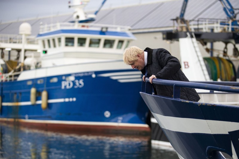 British Prime Minister Boris Johnson, peering over the bow of a trawler in Scotland on Sept. 6, 2019, made control of fisheries in Brexit a big part of his successful election campaign.