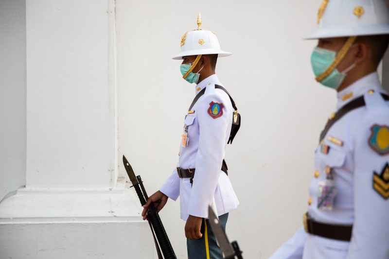 Palace guards wear medical masks in Bangkok on Feb. 4.