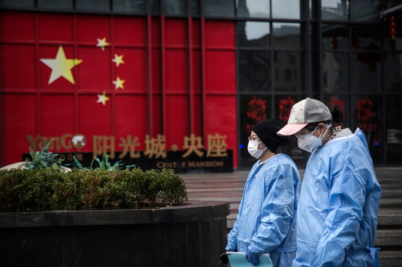 Two women wear protective clothing on the street in Wuhan, China, on February 10.