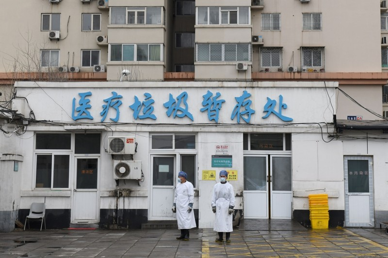 Workers at Youan Hospital in Beijing