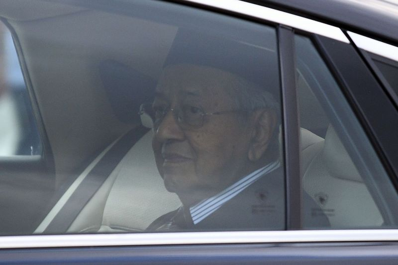 Mahathir Mohamad looks on as he leaves the National Palace in Kuala Lumpur on Feb. 24.