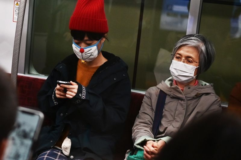 People wearing face masks in Tokyo during the coronavirus crisis.
