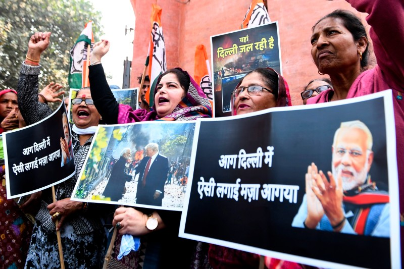 Indian National Congress workers shout slogans against Indian Prime Minister Narendra Modi during a protest in Amritsar on Feb. 26.